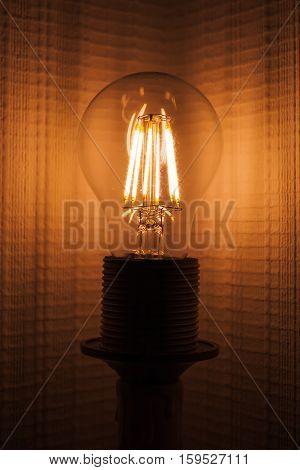 Retro Tungsten Lamp Glowing In Dark