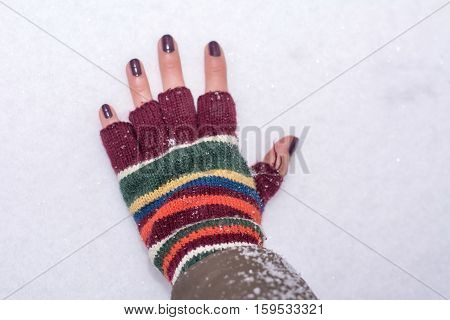 Hand In Winter Gloves Touching Snow Covered Covered Ground