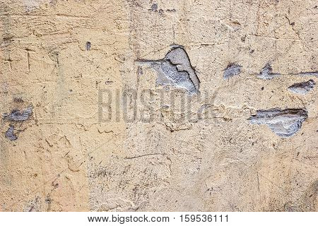 Cracked concrete vintage wall background,old dry damaged wall. Texture of old plaster wall rusty old-fashioned with space for your design. Grunge wall of the old house abstract horizontal.