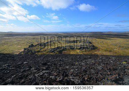 Moss covered field of lava rock on Snaefellsnes Peninsula in Iceland.