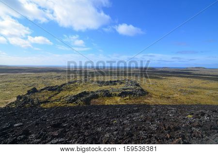 Moss covered lava rock surrounding Eldborg Crater in Iceland.