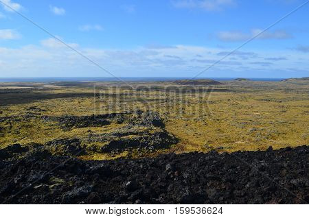 Moss covered lava field in Iceland as seen from a volcanic crater.