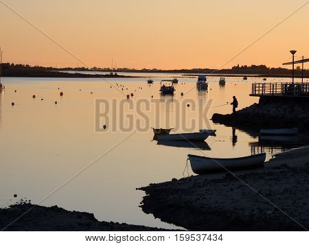 The Sun sets over the lagoon at Cabanas, Portugal.