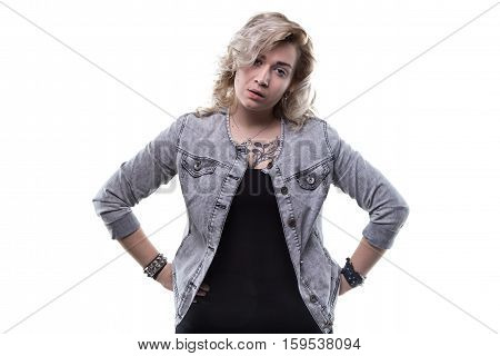 Unsatisfied young blond woman on white background