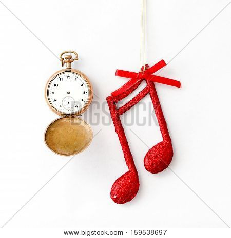 picture of a Christmas decoration with musical notes on white background.