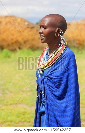 Africa Tanzania - February 2016: Masai woman of the tribe in a village in traditional dress.