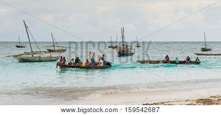 ZANZIBAR, TANZANIYA- JULY 15: beautiful landscape with fishing boats on the shore on July 15, 2016 in Zanzibar