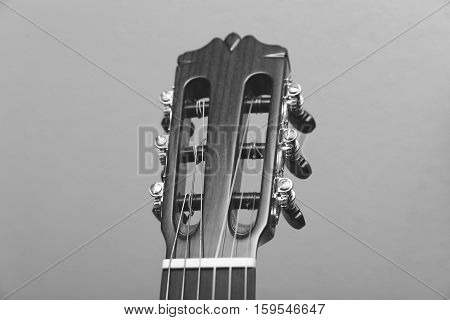 The front of the headstock of a classical, Spanish, or Flamenco guitar with nylon strings.