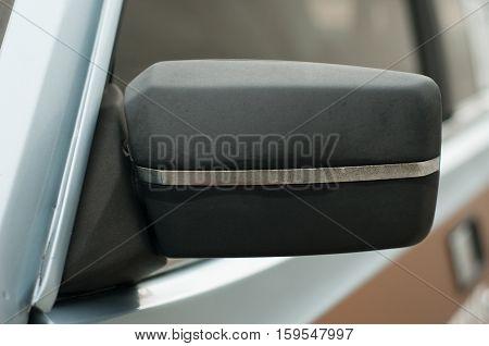 Vintage rear-view car mirror. Left side. Black color.