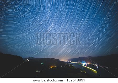 Star Trails Over Columbia River Gorge in Washington and Oregon. Long exposure showing blurred rotation of stars over The Gorge.