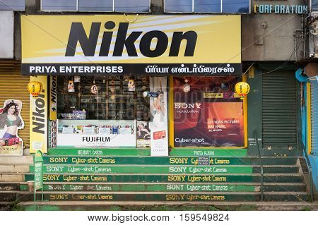 Nilgiri Hills India - October 25 2013: photography equipment shop downtown with colorful advertisements for Sony Nikon Fuji and other brands.