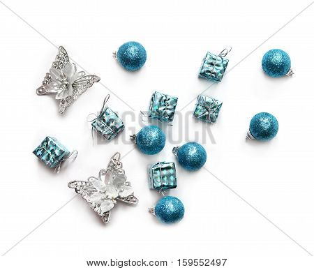 Christmas composition. Christmas gift, balls and butterfly. Top view, flat lay