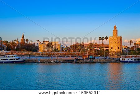 Seville sunset skyline torre del Oro and Giralda in Sevilla Andalusia Spain