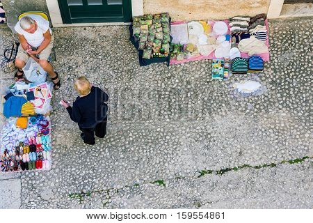 DUBROVNIK CROATIA - SEPTEMBER 22: This is Small market stall on a side street in Dubrovnik old town on September 22 2016 in Dubrovnik