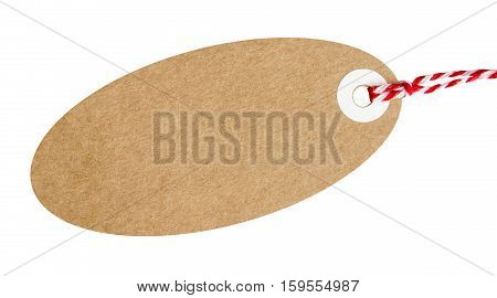 Oval gift tag made from brown recycled card with red and white string on an isolated background with a clipping path