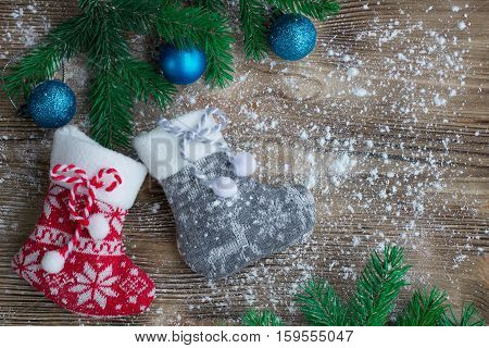Christmas Stockings On Snowbound Wooden Background With Blue Ball Ornaments