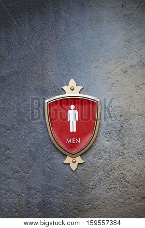 a men restroom sign on a concrete wall