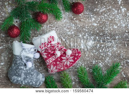 Christmas Stockings On Snowbound Wooden Background With Red Balls Ornaments