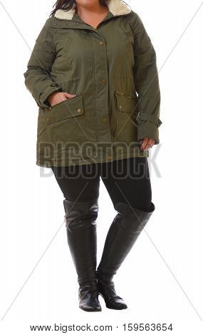 portrait of plus size model woman wearing XXL dark green winter coat and black leggins posing isolated on white background.