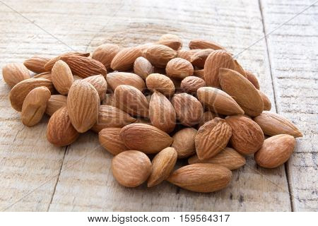 Pile Of Almonds On The Wooden Table