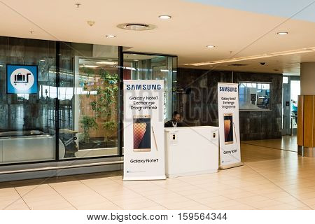 Cape Town, South Africa - November 24, 2016: A booth for exchanging the Samsung Galaxy Note 7 at the airport of Cape Town: Since the smart phone is facing problems with its battery that might explode, the phone is not allowed at most airports.