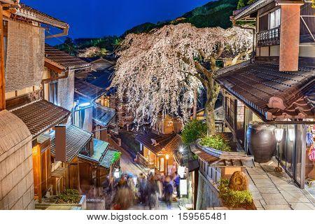 Kyoto, Japan alleyway scene in the Higashiyama district at night during the spring season.