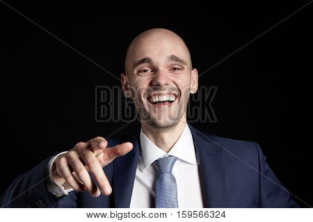 Laughing Businessman Pointing His Finger