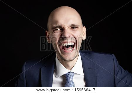 Laughing Businessman On Black Background
