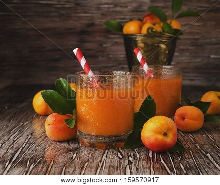 Fresh Apricot Juice In Glass On Wooden Table, Selective Focus