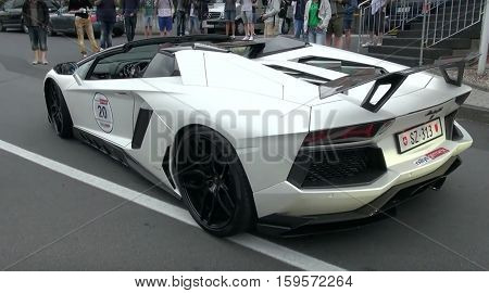 LONDON, UK, SEP 24, 2016: Lamborghini Aventador super car seen driving in the street