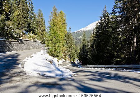 Dangerous road in the mountains with snow