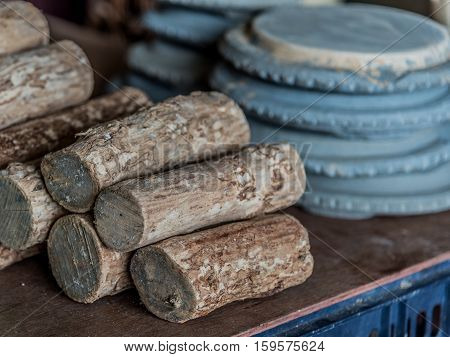 Thanaka woods and Kyauk pin stone slabs for grinding them to produce Thanaka cream. It is a yellowish-white cosmetic paste commonly seen applied to the face of women and girls in Myanmar.