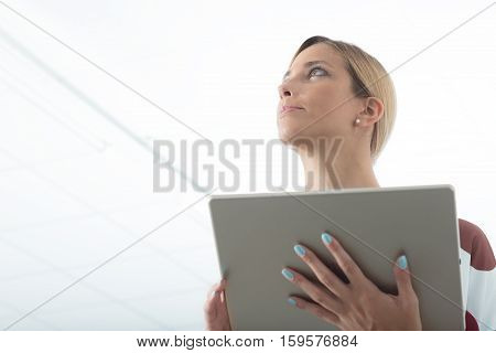 Woman In Office Workpace With Digital Tablet