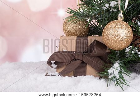 Brown gift box next to a Christmas tree on a colorful background