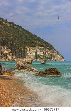 Baia dei Mergoli beach .MATTINATA (Apulia), - ITALY-Also known 'Baia Delle Zagare' (Orange flowers bay),the beach is doulbetless one of de most renowned seaside resort in the Gargano's promontory.