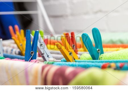 Close Up Clothes Dryer And Plastic Clips