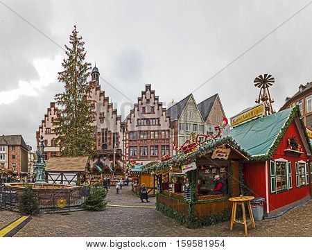 People Enjoy The Christmas Market At The Roemer
