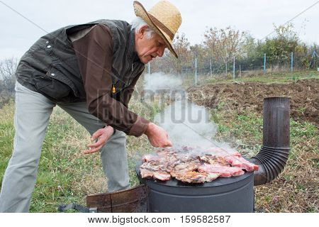 Grilling Meat On Wood Stove