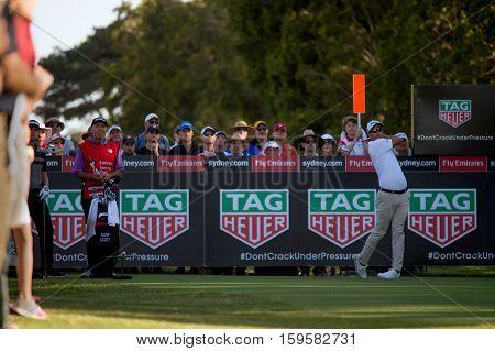 Sydney, Australia - November 17, 2016: Australian golfer Adam Scott hitting his tee shot on the 17th hole on day one of the Emirates Australian open at Royal Sydney Golf Club on November 17, 2016 in Sydney, Australia