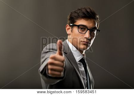 Handsome Young Business Man Showing Thumbs Up