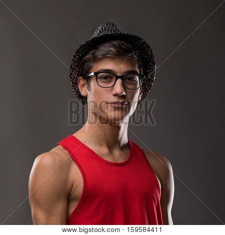 Smart Guy Smiling On A Hat And A Red Tank Top