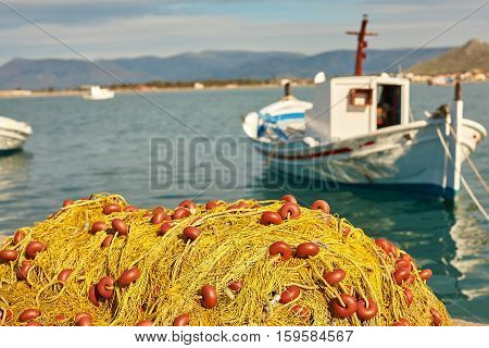 Pile Of Yellow Fishing Nets In Port