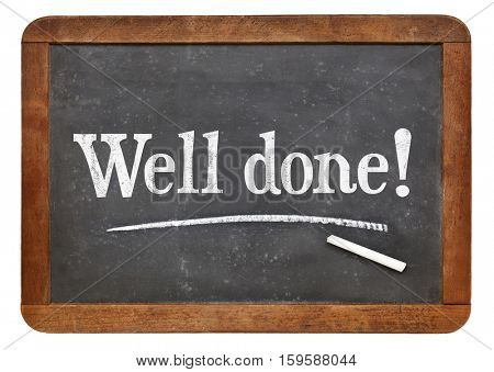 Well done sign - white chalk text on a vintage slate blackboard