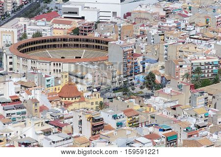 aerial view of some buildings of Alicante spain with the bullring on left top taken from Santa Barbara castle
