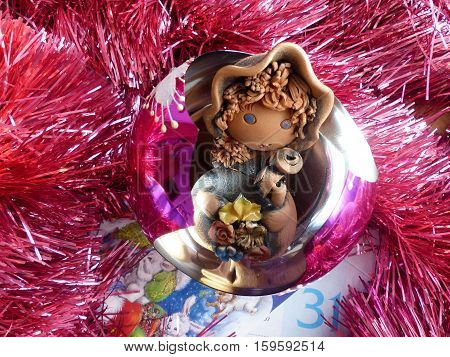 New Year's and Christmas. Gnome in the New Year's glass sphere. The interior of the New Year.
