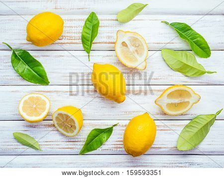 Fresh Lemons And  Lemons Leaves On Rustic Wooden Background. Fresh Lemons And Lemon Slice On Wooden