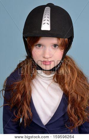 portrait of a redheaded girl jockey studio