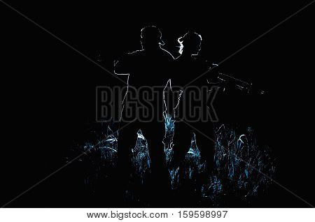 silhouette men and women in arms gun