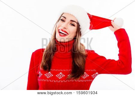 Portrait Of Cheerful Pretty Santa Woman Holding Pompon Of Hat