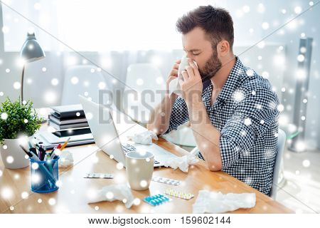 Portrait Of Businessman Having Cold On Snowy Winter Background